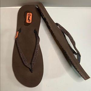 Teva flip flops.  Brown with orange trim.